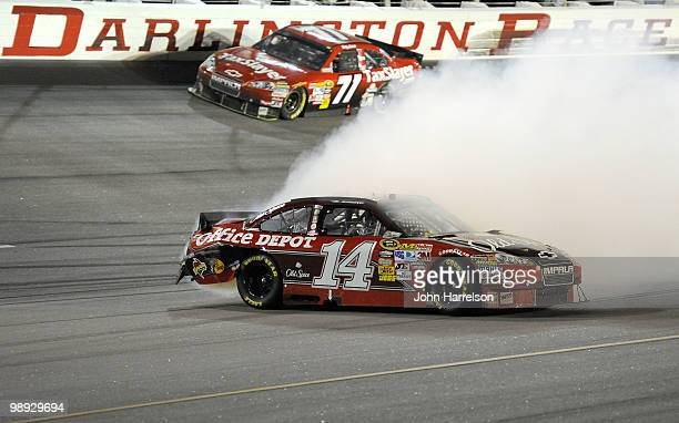 Smoke pours out the back of the Old Spice / Office Depot Chevrolet driven by Tony Stewart on track during the NASCAR Sprint Cup series SHOWTIME...