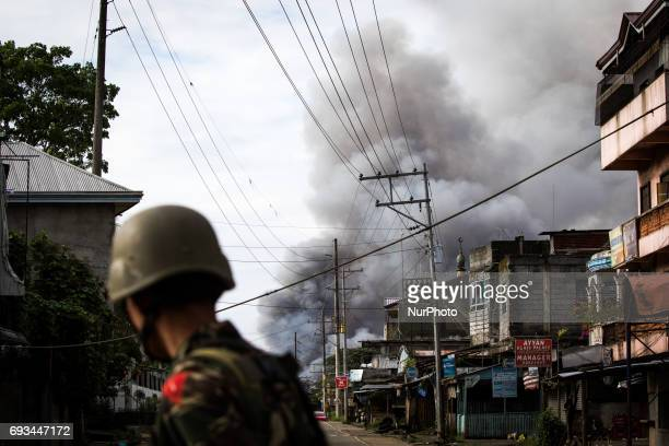 A smoke rages at houses following airstrikes by the Philippine Air Force in Marawi Southern Philippines June 6 2017 Philippine military jets fired...