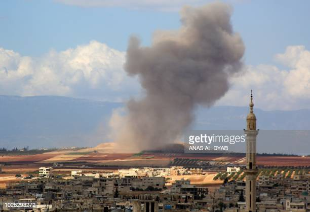 Smoke raises in the Syrian village of Kafr Ain in the southern countryside of Idlib province after an airstrike on September 7 2018 The presidents of...