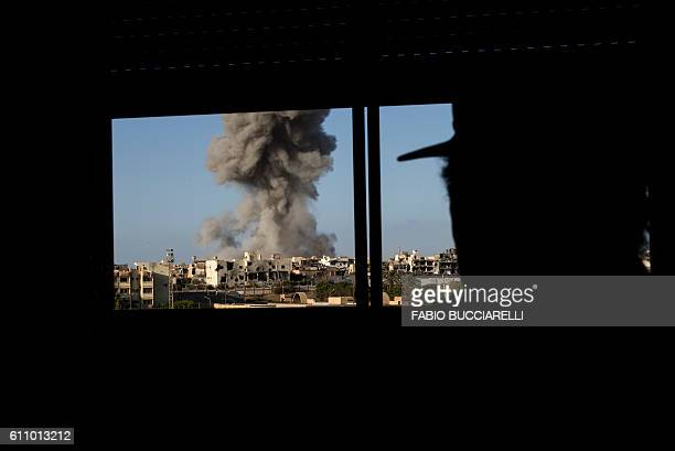 TOPSHOT Smoke rise after an airstrike on the District 3 of Sirte the last stronghold of Islamic State on September 28 2016 France will host an...