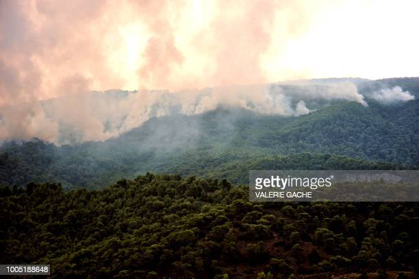 Smoke rise during a wildfire at the village of Kineta near Athens on July 25 2018 At least 79 people died in huge wildfires around Athens Greek...