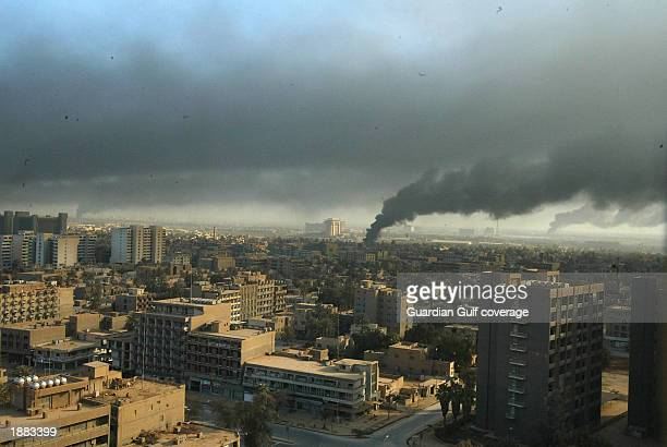 Smoke rises above Baghdad March 28 2003 in Iraq US bombing continues as coalition forces carry out an operation to oust Iraqi President Saddam...