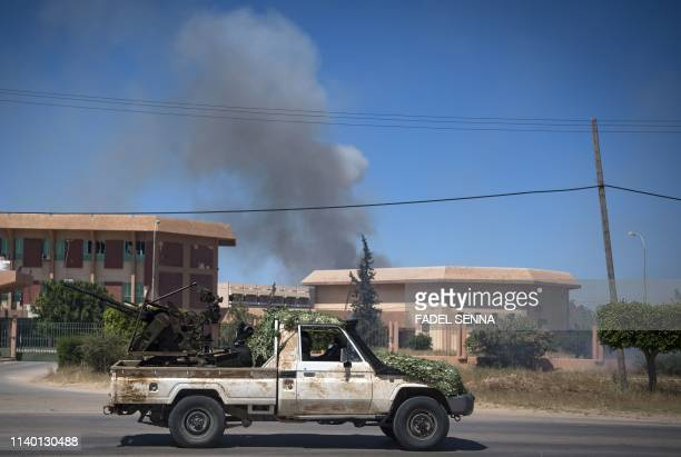 Smoke rises above buildings during and forces loyal to strongman Khalifa Haftar, in Espiaa, about 40 kilometres south of the Libyan capital Tripoli...