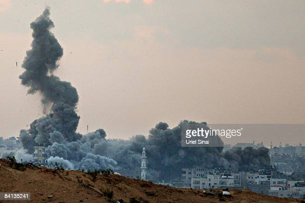 Smoke rises above Gaza after another Israeli air strike on a Hamas target December 29 2008 along Israel's side of the Gaza border The Israeli Air...