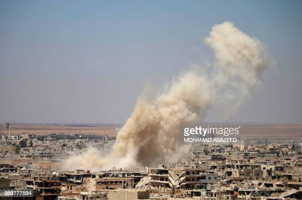 Smoke rises above opposition held areas of Daraa during an airstrike by Syrian regime forces on June 25 2018 Russianbacked regime forces have for...