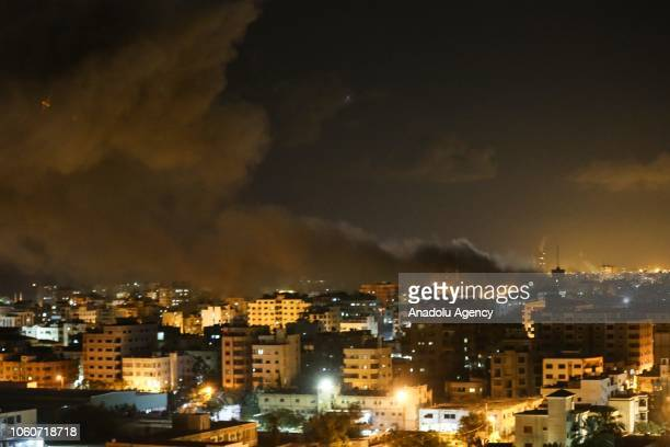 Smoke rises above the Hamasrun AlAqsa TV during Israeli airstrikes to positions in Gaza on November 12 2018