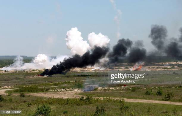 Smoke rises above the site of the projectile during the tactical battalion exercises of a separate mechanized brigade of the North operational...