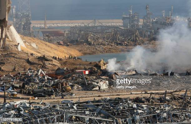 Smoke rises above wreckage in the city's port, devastated by an explosion a day earlier, on August 5, 2020 in Beirut, Lebanon. As of Wednesday...