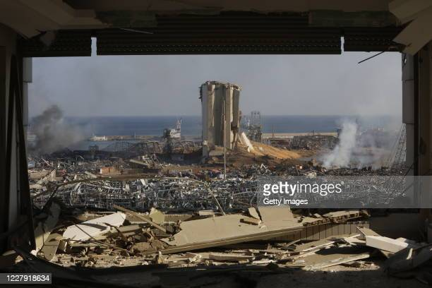Smoke rises above wrecked buildings at the citys port, devastated by an explosion a day earlier, on August 5, 2020 in Beirut, Lebanon. As of...