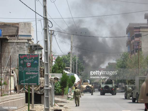 Smoke rises after a bomb and gun attack near a training center for midwives near the city center of Jalalabad Afghanistan on July 28 2018