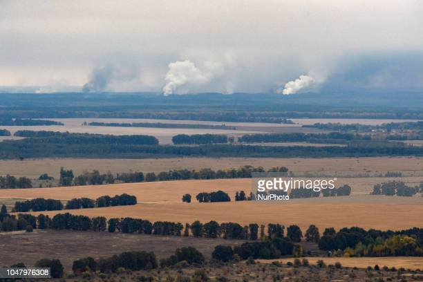 Smoke rises after a fire and explosions hit the Ukrainian defence ministry ammunition depot in the eastern Chernigov region Ukraine October 9 2018