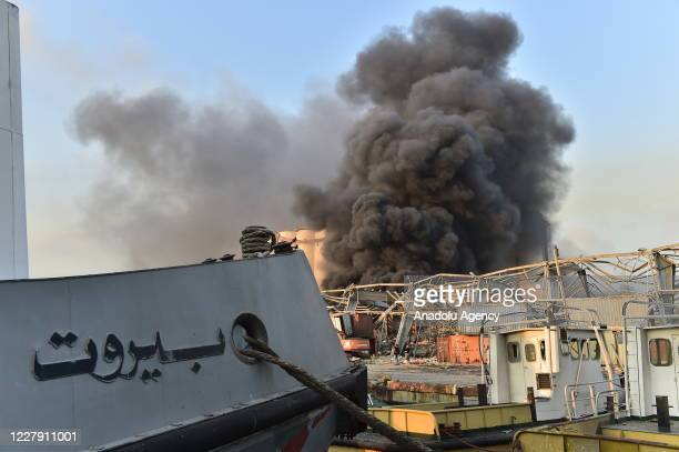 Smoke rises after a fire at a warehouse with explosives at the Port of Beirut led to massive blasts in Beirut, Lebanon on August 4, 2020. A large...