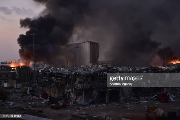Smoke rises after a fire at a warehouse with explosives at the Port of Beirut led to massive blasts in Beirut Lebanon on August 4 2020 A large number...