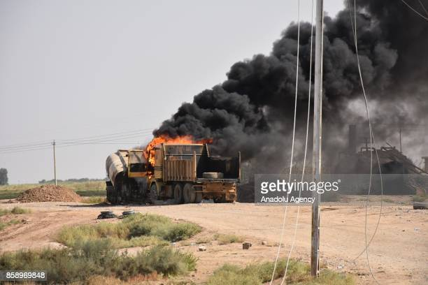 Smoke rises after a fire breaks out as Daesh militants steal crude oil to make smuggled fuel petroleum pipelines of Riyadh town of Havice district...