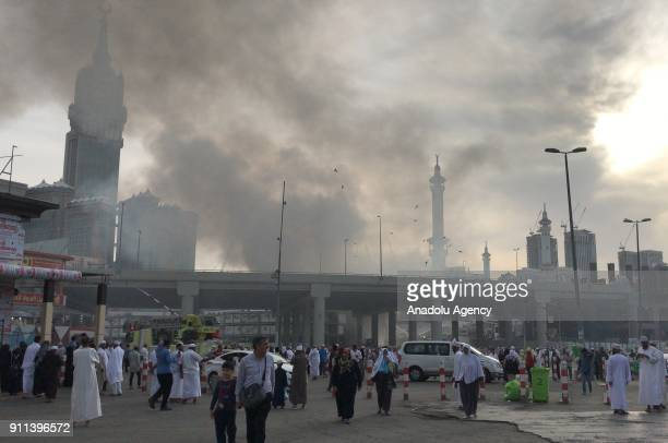 Smoke rises after a fire broke out on January 28 2018 at a 4storeybuilding near the Masjid alHaram in Mecca Saudi Arabia