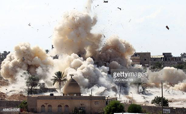 Smoke rises after a house was blown up during a military operation by Egyptian security forces in the Egyptian city of Rafah near the border with...