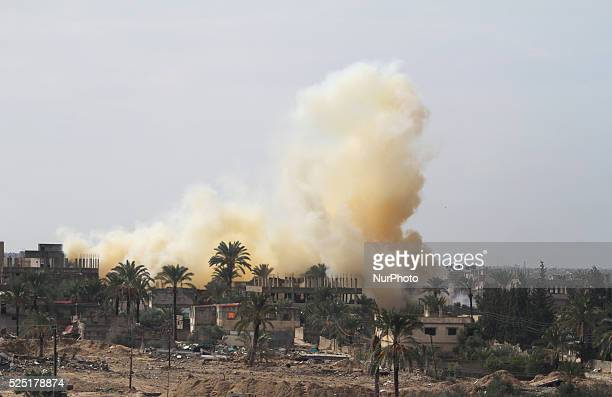 Smoke rises after a house was blown up during a military operation by Egyptian security forces in Rafah near the border with southern Gaza Strip on...