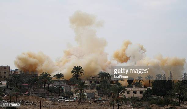 Smoke rises after a house was blown up during a military operation by Egyptian security forces in Rafah, near the border with southern Gaza Strip on...