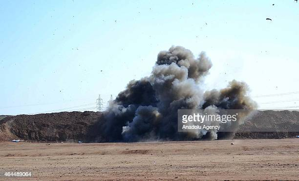 Smoke rises after a military show during a ceremony held after the completion of the 15 days expedited military training that provided by the members...