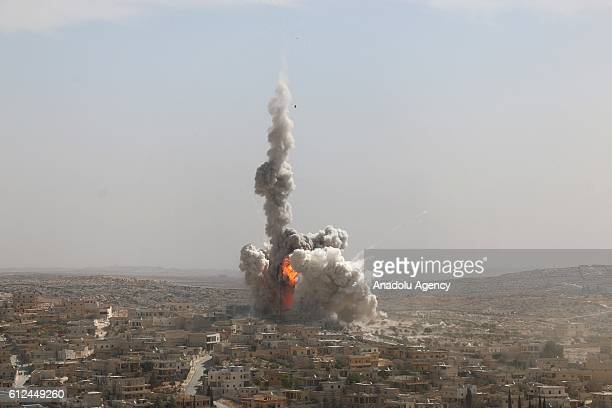 Smoke rises after a warcraft belonging to the Russian Army bombed a residential area in the Darat Izza neighborhood of Aleppo Syria on October 4 2016