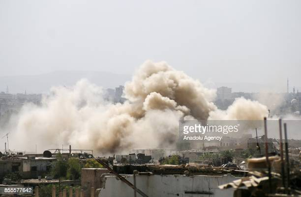 Smoke rises after air and ground strikes over the deconflict zone Cobar district of Eastern Ghouta in Damascus Syria on September 29 2017