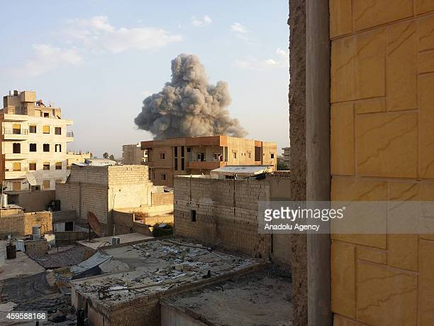 Smoke rises after air strikes by Syrian army warplanes on the ISILheld northern city of Raqqa Syria on November 25 2014 At least 130 people have been...