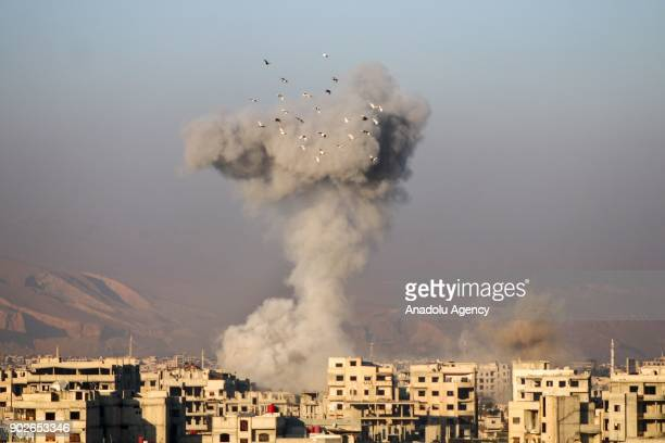 Smoke rises after airstrikes carried out by the warplanes of Assad Regime in the deescalation zones of Arbin and Harasta town in the besieged Eastern...
