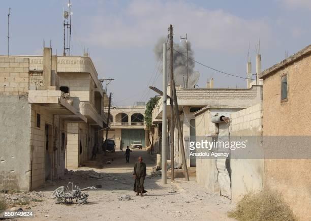 Smoke rises after airstrikes hit Khan Sheikhun town of Idlib Syria on September 21 2017