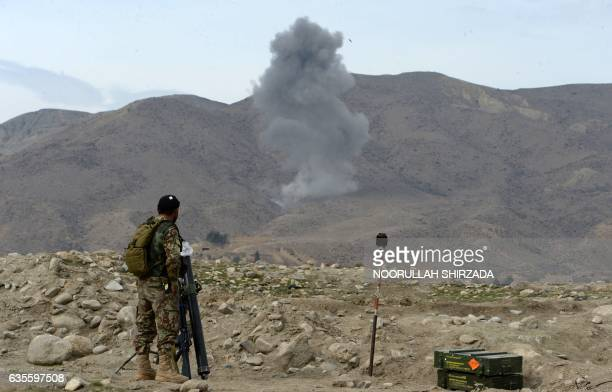 Smoke rises after an air strike by US aircraft on positions during an ongoing an operation against Islamic State militants in Kot district of...