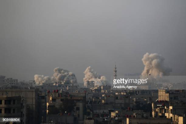 Smoke rises after an airstrike carried out by the warplanes of Assad Regime in the deescalation zone of Arbin town in the besieged Eastern Ghouta in...