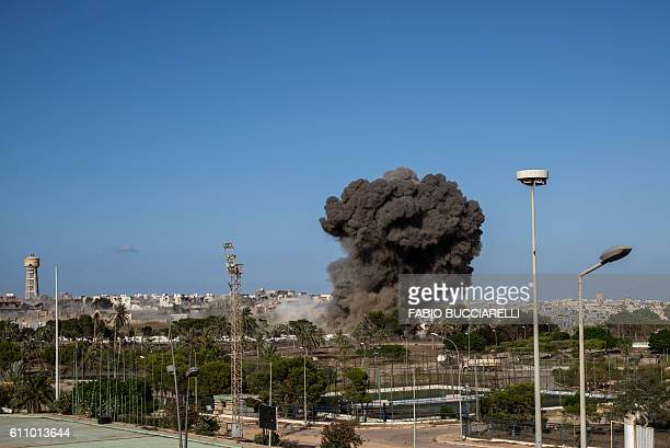 Smoke rises after an airstrike on District 3 the last stronghold of Islamic State members in Sirte on September 28 2016 Libya is facing political...