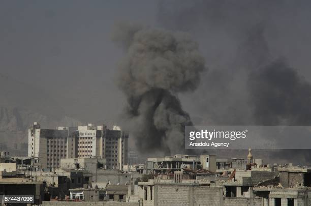 Smoke rises after an Assad regime's airstrike over residential areas in the deescalation zone of Arbin town of the Eastern Ghouta region in Damascus...