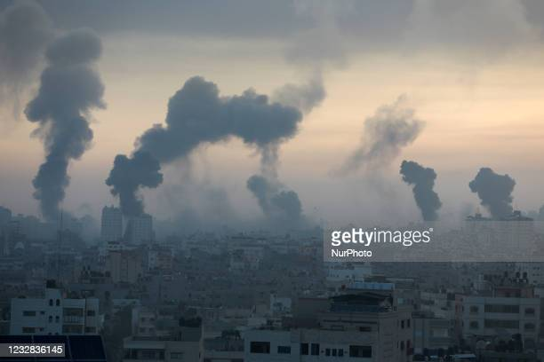Smoke rises after an Israeli air strike in Gaza City near Barcelona Park and multiple government places, one of the biggest air strikes on the Gaza...