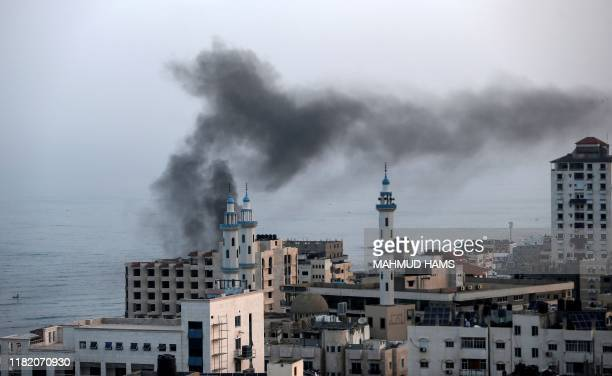 Smoke rises after an Israeli airstriked in Gaza City on November 13, 2019. - Israel's military killed a commander from Palestinian militant group...