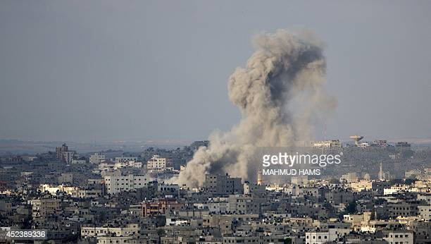 Smoke rises after an Israeli missile strike on Gaza City on July 19 2014 Israel's operation against Hamas saw one of its bloodiest days with 46...