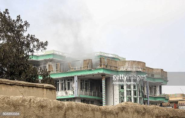 Smoke rises after an unknown number of assailants mounted an attack from a building close to the Indian consulate in MazariSharif Afghanistan on...