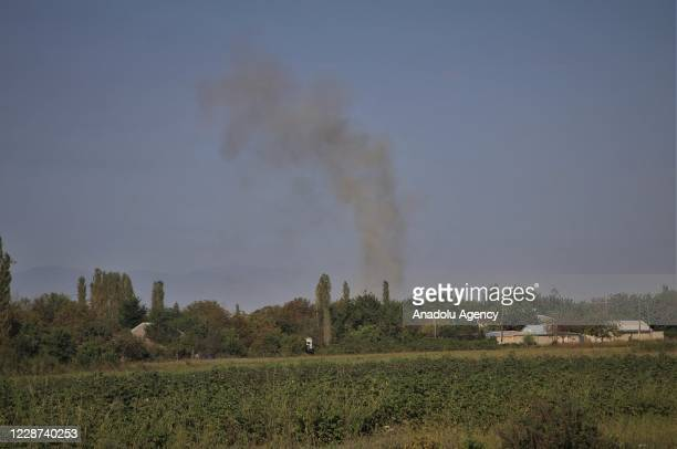 Smoke rises after Armenian attacks on Azerbaijan border in Azerbaijan on September 27, 2020. Border clashes broke out after Armenian forces opened...
