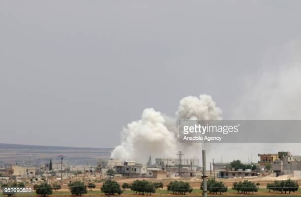 Smoke rises after Assad regime carried out airstrikes over Homs Syria on April 29 2018