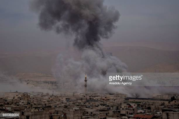 Smoke rises after Assad Regime forces carried out airstrikes in Eastern Ghouta's Douma town in Damascus Syria on March 20 2018 At least 59 civilians...