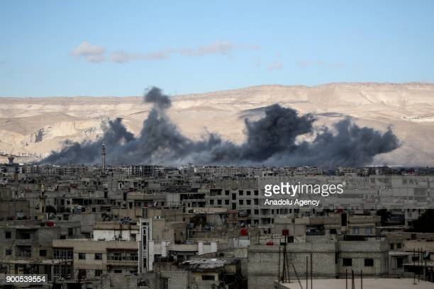 Smoke rises after Assad Regime's airplanes carried out airstrike over the besieged town of Arbin in Eastern Ghouta in Damascus Syria on January 2 2018