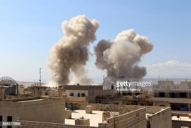 Smoke rises after Assad regime's airstrikes hit the town of Khan Shaykhun in Idlib in Syria on October 6 2017 At least 8 people killed in the...