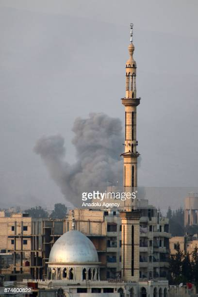 Smoke rises after Assad regime's warcrafts carried out an airstrike over residential areas of Arbin town of the Eastern Ghouta region of Damascus in...