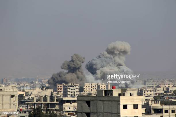 Smoke rises after Assad regime's warplane carried out airstrikes over Madyarah town of the Eastern Ghouta region in Damascus Syria on November 27 2017