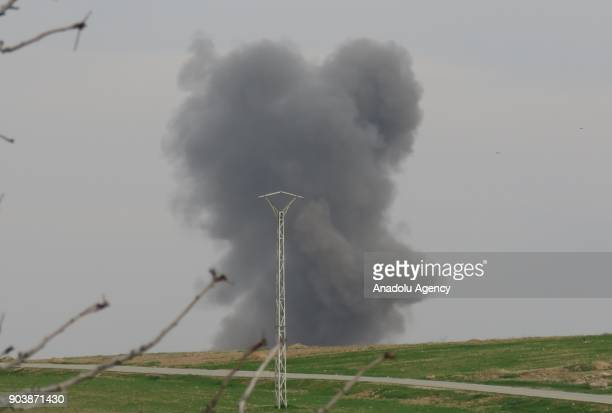 Smoke rises after clashes intensify around Abu alDuhur Military Airbase in Idlib Syria on January 11 2018 Assad Regime and its supporter terrorist...