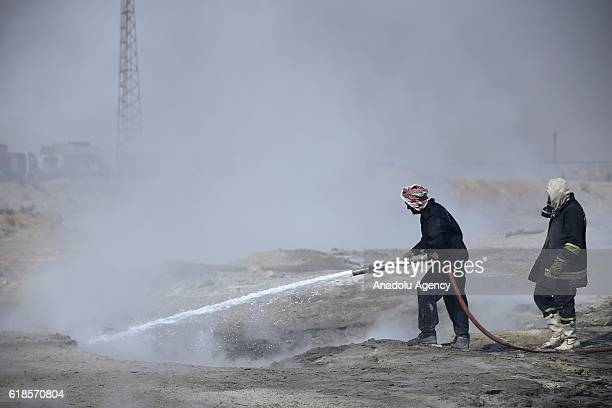 Smoke rises after Daesh torched Mishraq sulphur factory about 30 kilometres south of Mosul during an operation to retake Mosul on October 27 2016...