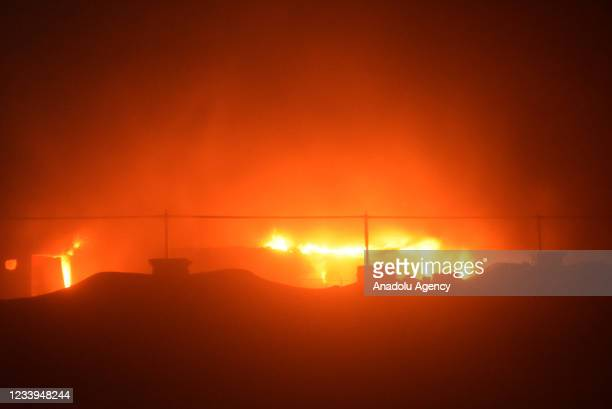 Smoke rises after fire broke out for an unknown reason in a COVID-19 isolation ward of Al-Hussein Hospital in Nasiriya city in Dhi Qar governorate,...