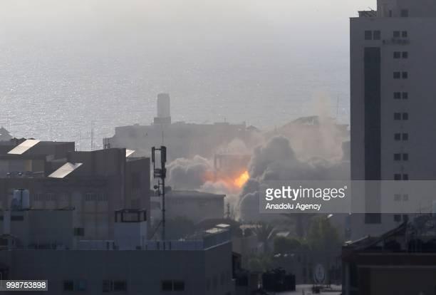Smoke rises after Israeli fighter jets pounded a building in Al Katiba region in Gaza City, Gaza on July 14, 2018.