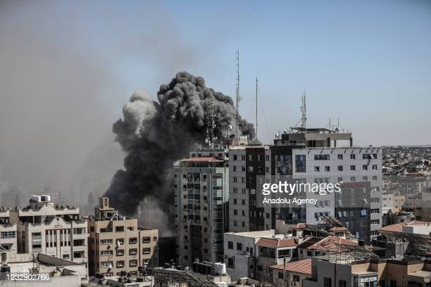 Smoke rises after Israeli forces destroyed a building in Gaza City where Al-Jazeera, Associated Press had their offices, on May 15, 2021.