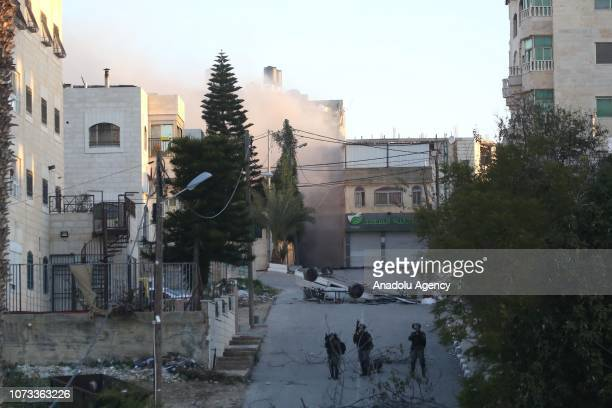Smoke rises after Israeli soldiers demolish the house of Latifa Abu Hamid mother of one killed and five Palestinian prisoners who are serving...