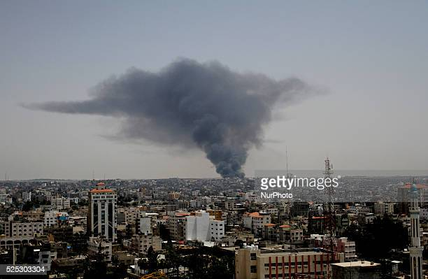 Smoke rises after Israeli tanks firing shells at the industrial area of Karni in the east of Gaza City 12 July 2014